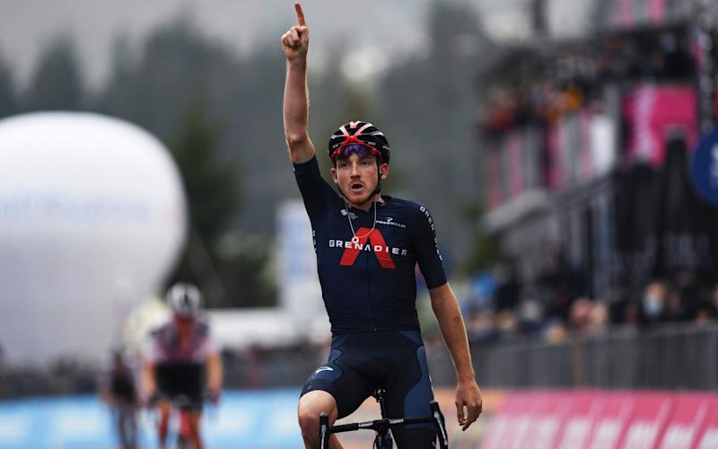 Tao Geoghegan Hart celebrates the biggest win of his career in the Italian Dolomites - GETTY IMAGES