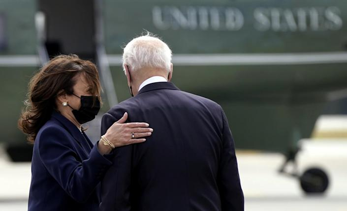 President Biden and Vice President Kamala Harris with Marine One in background