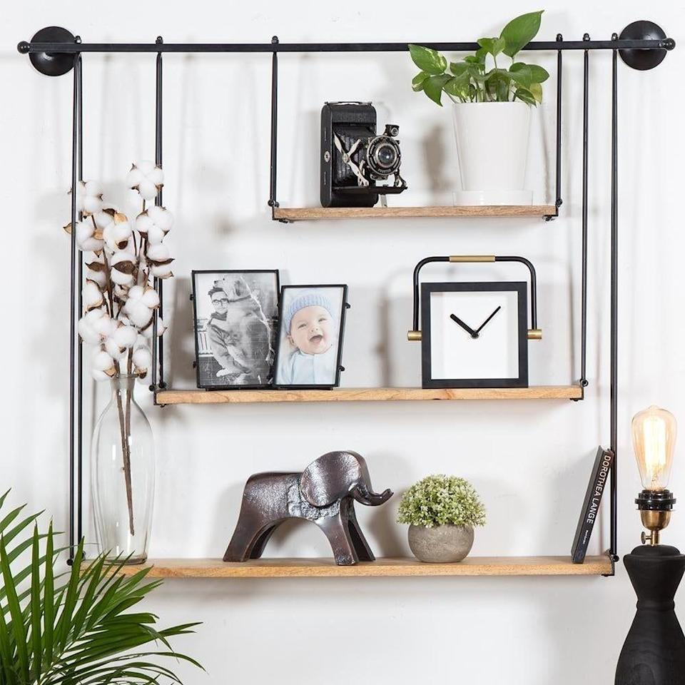 """<p><strong>Madeleine Home</strong></p><p>overstock.com</p><p><a href=""""https://go.redirectingat.com?id=74968X1596630&url=https%3A%2F%2Fwww.overstock.com%2FHome-Garden%2FLuna-Three-Tier-Suspended-Wall-Shelf%2F22418523%2Fproduct.html&sref=https%3A%2F%2Fwww.bestproducts.com%2Flifestyle%2Fg37357856%2Flabor-day-sales-2021%2F"""" rel=""""nofollow noopener"""" target=""""_blank"""" data-ylk=""""slk:Shop Now"""" class=""""link rapid-noclick-resp"""">Shop Now</a></p><p><del>$87.49</del><strong><br>$72.24 (17% off)</strong></p><p>Get ready to prep for your next #shelfie. This three-tier beauty is just as functional as it is fabulous. Shelves of varying lengths add some contrast, but the simple, clean lines keep it from looking cluttered. Imagine how great your books would look on this!</p>"""