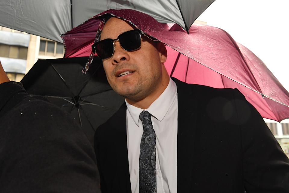 Jarryd Hayne (pictured) arrives, surrounded by supporters, at Newcastle District Court on May 06, 2021 in Newcastle, Australia.
