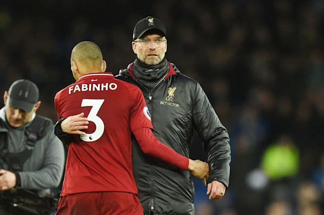 "Manager Jurgen Klopp, Fabinho and <a class=""link rapid-noclick-resp"" href=""/soccer/teams/liverpool/"" data-ylk=""slk:Liverpool"">Liverpool</a> are looking up at <a class=""link rapid-noclick-resp"" href=""/soccer/teams/manchester-city/"" data-ylk=""slk:Manchester City"">Manchester City</a> in the Premier League table. (Getty)"