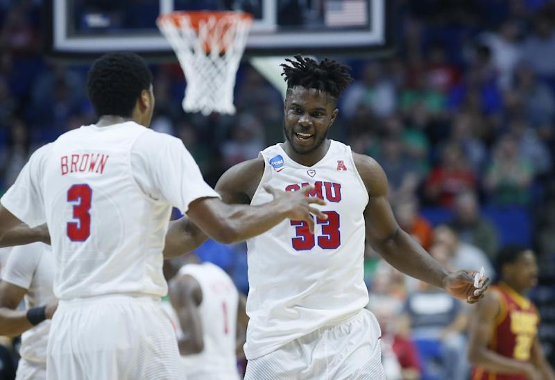 Southern Methodist forward Semi Ojeleye (33) celebrates a basket with teammate Sterling Brown (3) in the first half of a first-round game against Southern California in the men's NCAA college basketball tournament in Tulsa, Okla., Friday, March 17, 2017. (AP Photo/Sue Ogrocki)
