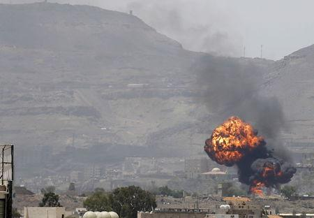 Smoke and balls of fire rise from a military base after it was hit by Saudi-led air strikes in Yemen's capital Sanaa
