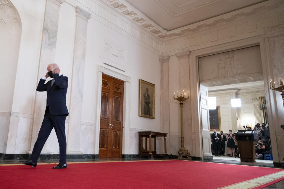 President Joe Biden walks from the podium after speaking about the end of the war in Afghanistan from the State Dining Room of the White House, Tuesday, Aug. 31, 2021, in Washington. (AP Photo/Evan Vucci)