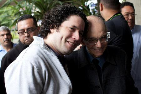 FILE PHOTO: Venezuelan conductor Gustavo Dudamel (L) and the founder of the National System of Children and Youth Orchestras of Venezuela Jose Antonio Abreu attend a free concert by the Simon Bolivar Youth Symphonic Orchestra at the Teresa Carreno theater in Caracas February 16, 2012. REUTERS/Carlos Garcia Rawlins/File Photo