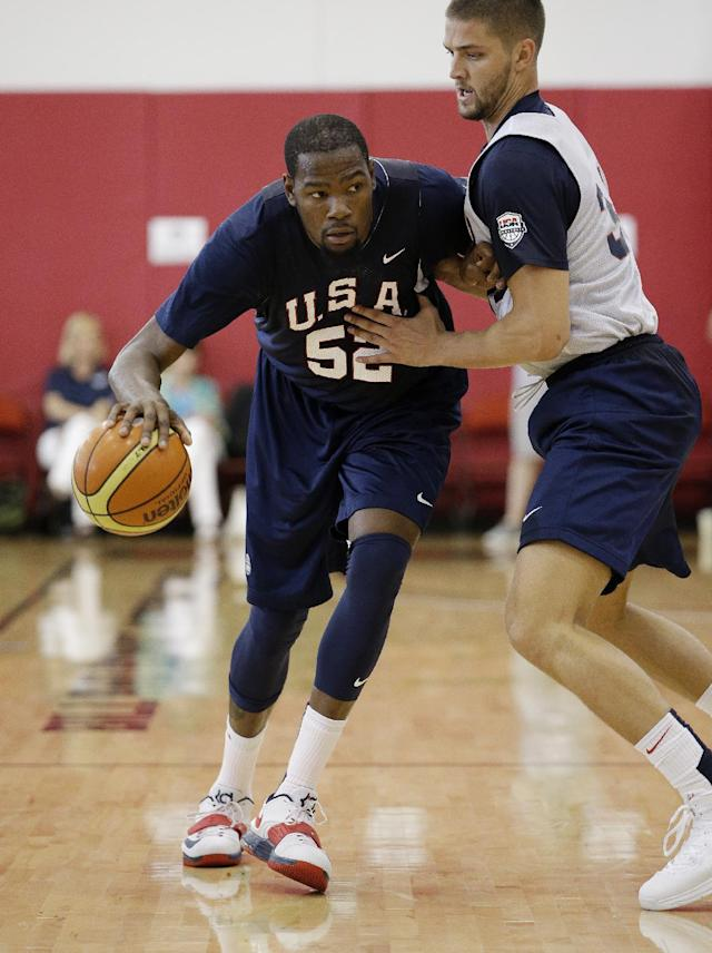 Oklahoma City Thunder's Kevin Durant (52) drives by Dallas Mavericks' Chandler Parsons during a USA Basketball minicamp scrimmage Monday, July 28, 2014, in Las Vegas. (AP Photo/John Locher)