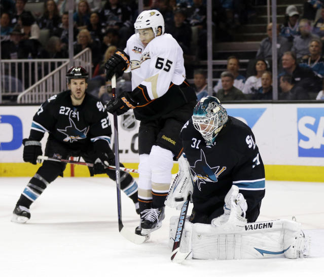 San Jose Sharks goalie Antti Niemi (31), of Finland, stops a shot next to Anaheim Ducks' Emerson Etem (65) and Sharks' Scott Hannan (27) during the second period of an NHL hockey game on Thursday, March 20, 2014, in San Jose, Calif. (AP Photo/Marcio Jose Sanchez)