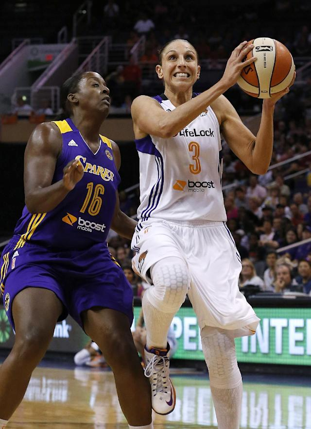 Phoenix Mercury's Diana Taurasi (3) gets past Los Angeles Sparks' Ebony Hoffman (16) for a shot during the first half in a WNBA basketball game on Friday, June 14, 2013, in Phoenix. (AP Photo/Ross D. Franklin)