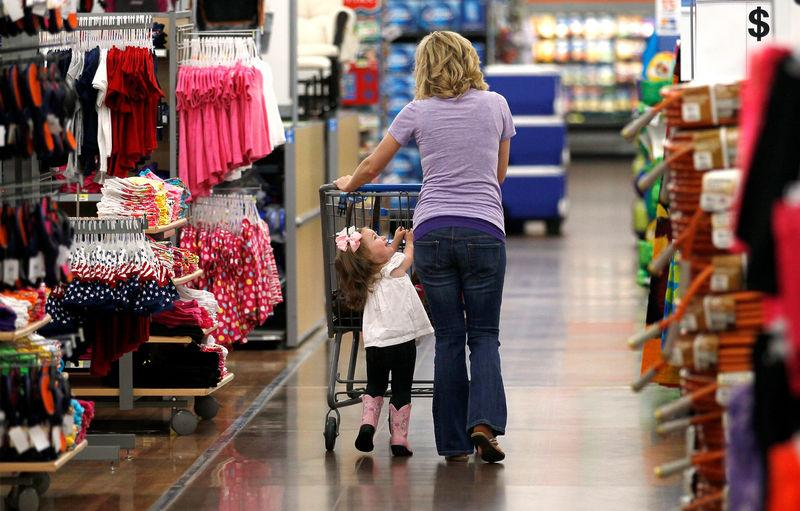 FILE PHOTO: A woman shops with her daughter at a Walmart Supercenter in Rogers