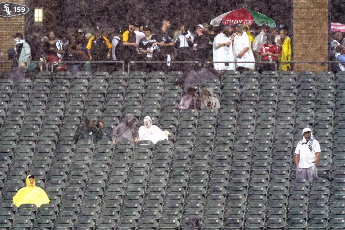 Fans look to the field as they wait during a rain delay in the third inning of a baseball game between the Seattle Mariners and the Chicago White Sox in Chicago, Saturday, June 26, 2021. (AP Photo/Nam Y. Huh)