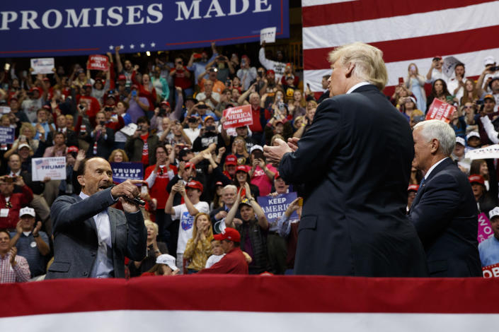 Singer Lee Greenwood points at President Donald Trump and Vice President Mike Pence as he sings during a campaign rally, Sunday, Nov. 4, 2018, in Chattanooga, Tenn. (AP Photo/Evan Vucci)