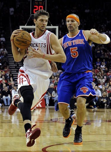 Houston Rockets' Chandler Parsons (25) flies up court followed by New York Knicks' Jason Kidd (5) in the second half of an NBA basketball game Friday, Nov. 23, 2012, in Houston. (AP Photo/Pat Sullivan)