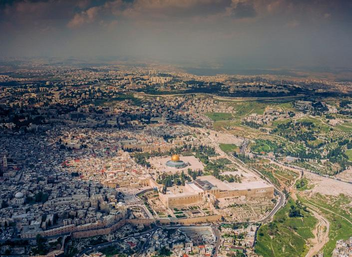A rare aerial view of Jerusalem's walled Old City and the Mount of Olives, sacred ground for half our population. (Image exclusive to The Huffington Post)