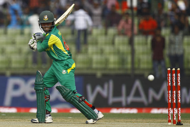 Bangladesh's Mominul Haque plays a shot during the Asia Cup one-day international cricket tournament against India in Fatullah, near Dhaka, Bangladesh, Wednesday, Feb. 26, 2014. (AP Photo/A.M. Ahad)