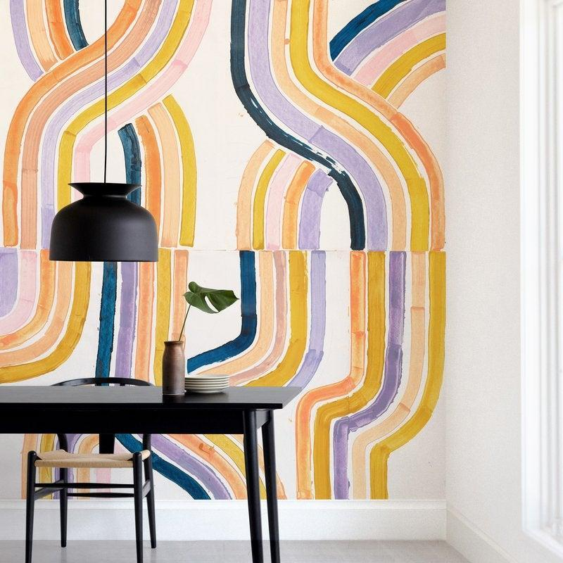 "<h3>Consider Wall Murals</h3> <br>""<a href=""https://web-mintedblue-prodxenial.minted.com/lp/removable-wall-murals"" rel=""nofollow noopener"" target=""_blank"" data-ylk=""slk:Wall murals"" class=""link rapid-noclick-resp"">Wall murals</a> are huge right now. Gracing interiors for centuries, wall murals were traditionally hand-painted and very expensive. However, advancements in large-scale printing technology have made murals significantly more affordable and opened up the creative possibilities.<br><br>Minted wall murals are easy to apply and made from recycled materials with a high-end matte, woven look. Whether you choose a figurative or abstract design, a mural is a great way to truly transform a room. And Minted wall murals are removable, so there's no commitment and they're great for rentals."" — Art Stylist at <a href=""https://www.minted.com/"" rel=""nofollow noopener"" target=""_blank"" data-ylk=""slk:Minted"" class=""link rapid-noclick-resp"">Minted</a>.<br><br><strong>Lise Gulassa</strong> ""dawnlight"" Removable Wall Mural, $, available at <a href=""https://go.skimresources.com/?id=30283X879131&url=https%3A%2F%2Fwww.minted.com%2Fproduct%2Fwall-murals%2FMIN-TYR-GWM%2Fdawnlight"" rel=""nofollow noopener"" target=""_blank"" data-ylk=""slk:Saatchi"" class=""link rapid-noclick-resp"">Saatchi</a><br><br><br>"