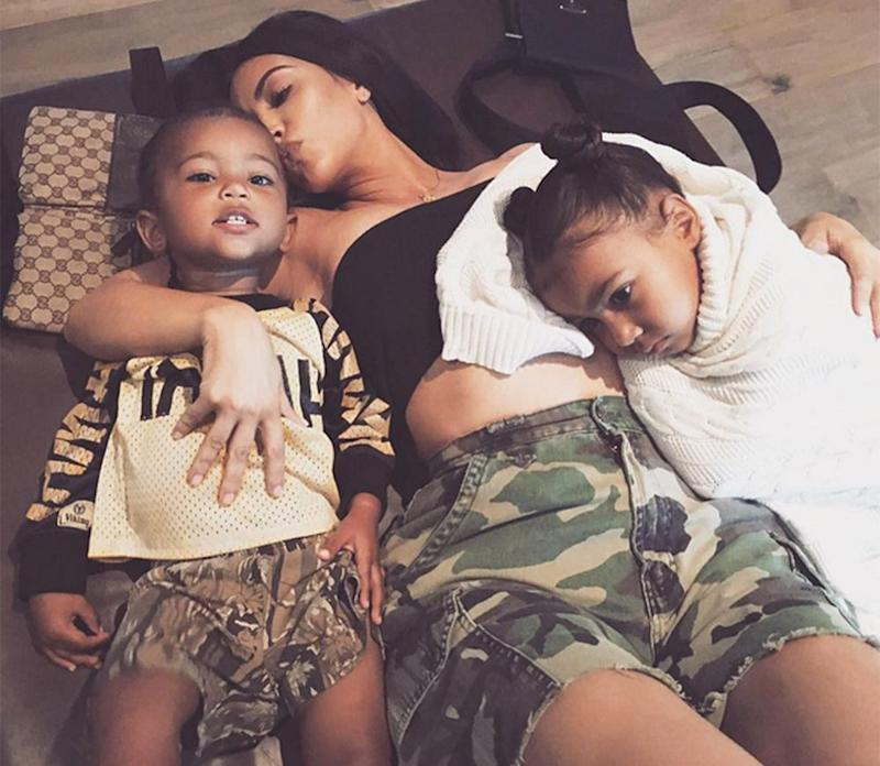Kim Kardashian with Saint and North in August