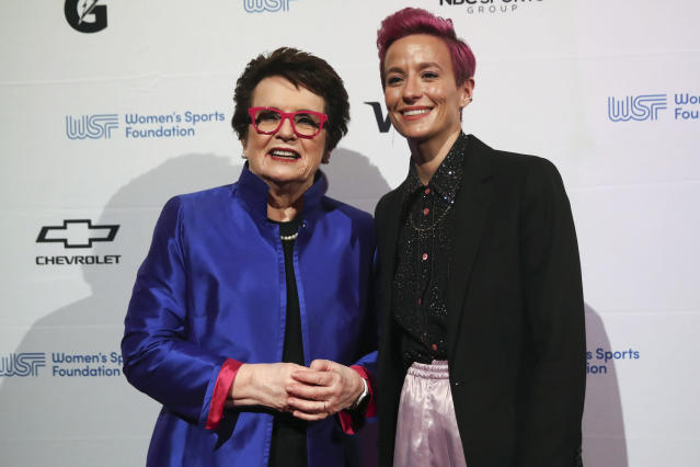In this Wednesday, Oct. 16, 2019, photo tennis great and founder of the Women's Sports Foundation Billie Jean King, left, and soccer star Megan Rapinoe pose for photos on the red carpet of the Women's Sports Foundation's 40th annual Salute to Women in Sports in New York. Rapinoe, who was honored at the gala, won Sportswoman of the Year in the team category. She led the U.S. women's soccer team to victory at the World Cup in France and earned the FIFA Player of the Year award. (AP Photo/Mary Altaffer)