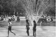 <p>Girls play in the Washington Square fountain to beat the summer heat.</p>