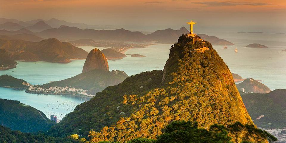 """<p>Rio de Janeiro has plenty of iconic attractions, including <span class=""""redactor-unlink"""">Copacabana Beach</span>, <span class=""""redactor-unlink"""">Ipanema Beach</span> (cue Antonio Carlos Jobim's famous """"Girl from Ipanema"""" bossa nova song), and the <a href=""""https://www.tripadvisor.com/Attraction_Review-g303506-d554128-Reviews-Corcovado_Christ_the_Redeemer-Rio_de_Janeiro_State_of_Rio_de_Janeiro.html"""" rel=""""nofollow noopener"""" target=""""_blank"""" data-ylk=""""slk:Christ the Redeemer statue"""" class=""""link rapid-noclick-resp"""">Christ the Redeemer statue</a>, but <a href=""""https://www.tripadvisor.com/Attraction_Review-g303506-d311247-Reviews-Sugarloaf_Mountain-Rio_de_Janeiro_State_of_Rio_de_Janeiro.html"""" rel=""""nofollow noopener"""" target=""""_blank"""" data-ylk=""""slk:Sugarloaf Mountain"""" class=""""link rapid-noclick-resp"""">Sugarloaf Mountain</a> is perhaps its most well-known landmark. The bullet-shaped mountain sits at the mouth of the Guanabara Bay, and you can take a cable car to the summit for views over the entire city. </p>"""