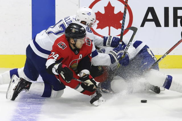 Ottawa Senators defenceman Mark Borowiecki (74) collides with Tampa Bay Lightning centre Alex Killorn (17) and centre Anthony Cirelli during second period of NHL hockey action in Ottawa, Saturday, Oct. 12, 2019. (Fred Chartrand/The Canadian Press via AP)