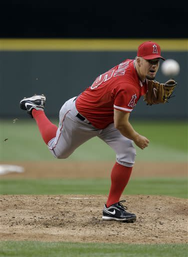Los Angeles Angels starting pitcher Joe Blanton throws against the Seattle Mariners in the third inning of a baseball game against the Seattle Mariners, Saturday, April 27, 2013, in Seattle. (AP Photo/Ted S. Warren)