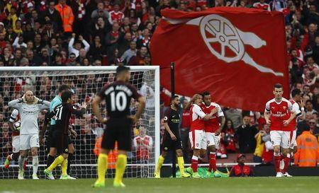 Britain Football Soccer - Arsenal v Manchester City - Premier League - Emirates Stadium - 2/4/17 Arsenal's Theo Walcott celebrates scoring their first goal with team mates Reuters / Eddie Keogh Livepic