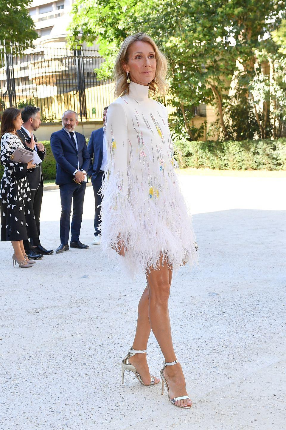 <p>The singer turned heads in a white feathered minidress, silver heels, and yellow drop earrings at the Valentino Haute Couture show during Paris Fashion Week.</p>