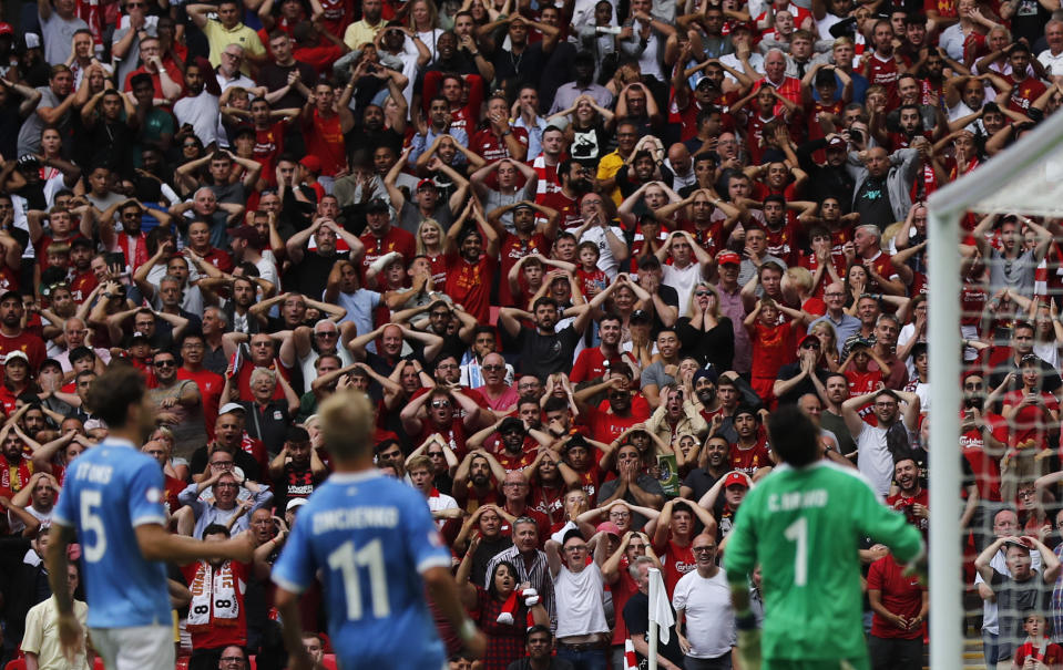 Liverpool fans react after Manchester City's Kyle Walker cleared the ball off the line from a shot by Liverpool's Mohamed Salah during the Community Shield soccer match between Manchester City and Liverpool at Wembley Stadium in London, Sunday, Aug. 4, 2019. (AP Photo/Frank Augstein)