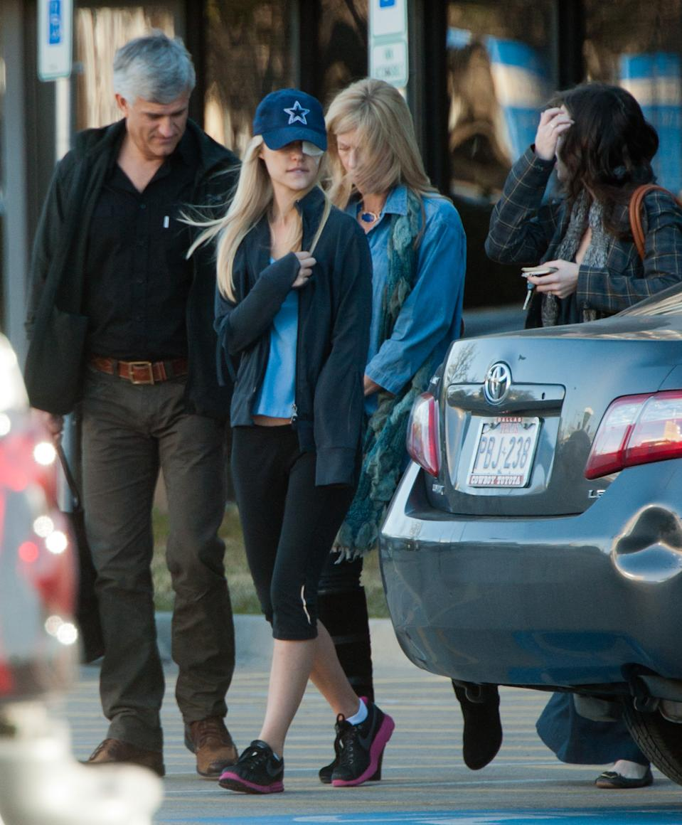 She was picked up at the center by her parents Cheryl and Jeff Scruggs and twin sister Brittany. The model seemed in good spirits as she left the center. She was also seen earlier in the morning when her doting dad dropped her off at the rehab center. The pair shared a hug as they said goodbye.