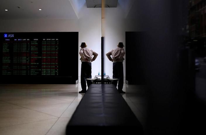 <p>An investor is reflected in a window as he looks at boards displaying stock prices at the Australian Securities Exchange (ASX) in Sydney, Australia, Sept. 30, 2016. (Photo: Steven Saphore/Reuters)</p>