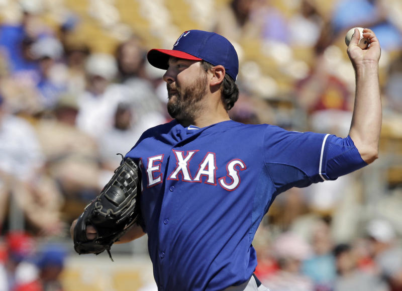 Texas Rangers' Joe Saunders pitches against the Chicago White Sox in the first inning of an exhibition baseball game Tuesday, March 11, 2014, in Glendale, Ariz. (AP Photo/Mark Duncan)