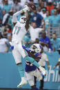 Buffalo Bills cornerback Tre'Davious White (27) defends Miami Dolphins wide receiver DeVante Parker (11) as he can't hold onto a pass in the endzone, during the first half of an NFL football game, Sunday, Sept. 19, 2021, in Miami Gardens, Fla. (AP Photo/Hans Deryk)