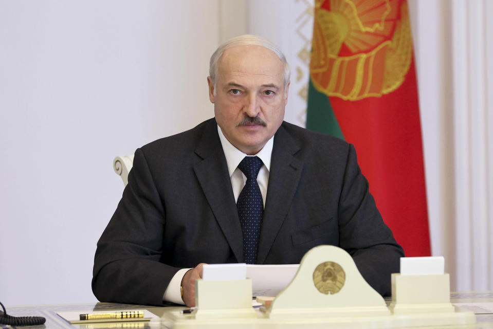 Belarusian President Alexander Lukashenko listens during a meeting in Minsk, Belarus, Thursday, Aug. 13, 2020. Crowds of protesters in Belarus swarmed the streets and thousands of workers rallied outside industrial plants Thursday to denounce a police crackdown on demonstrations over a disputed election that extended the 26-year rule of authoritarian President Alexander Lukashenko. (Nikolai Petrov/BelTA, Pool Photo via AP)