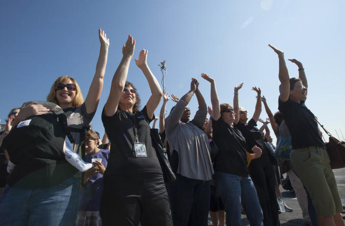 Supporters cheer Jenn Gibbons as she completes a 1,500 mile rowing trip around Lake Michigan to raise money for an organization helping cancer survivors on Tuesday, Aug. 14, 2012 in Chicago. The trip helped 27-year-old Gibbons raise $113,000 for Recovery on Water (ROW)(AP Photo/Sitthixay Ditthavong)