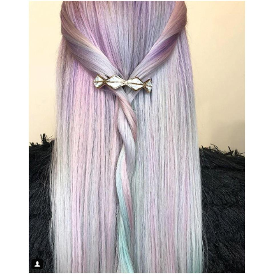 "San Francisco-based colorist Rachel Stefanik created this prominently lavender pastel version of the hair trend. We love the contrasting touches of blue and green in this one. The twisted style and hair accessory are giving us <a href=""https://www.allure.com/story/game-of-thrones-hair-instagram?mbid=synd_yahoo_rss"" rel=""nofollow noopener"" target=""_blank"" data-ylk=""slk:Khaleesi"" class=""link rapid-noclick-resp"">Khaleesi</a> weekend vibes."