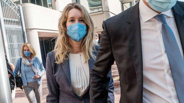 PHOTO: Elizabeth Holmes, founder and former CEO of Theranos, leaves the courthouse with her husband, Billy Evans after the first day of her fraud trial in San Jose, Calif., Sept. 8, 2021. (Nick Otto/AFP via Getty Images)