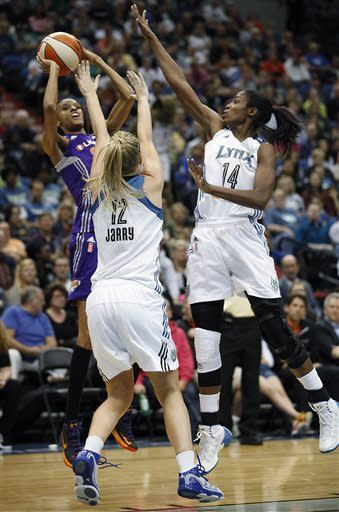 Phoenix Mercury guard DeWanna Bonner (24) shoots against Minnesota Lynx forwards Rachel Jarry (12) and Devereaux Peters in the second half of a WNBA basketball game, Thursday, June 6, 2013, in Minneapolis. The Lynx won 99-79. (AP Photo/Stacy Bengs)