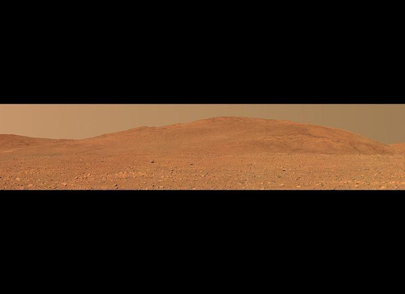 "Spirit's last Postcard of the Columbia Hills, taken from the plains of Gusev Crater, before the rover climbed up into the hills. <em>Mission sol 149 (June 4, 2004). From ""Postcards from Mars"" by Jim Bell; Photo credit: NASA/JPL/Cornell University </em>"