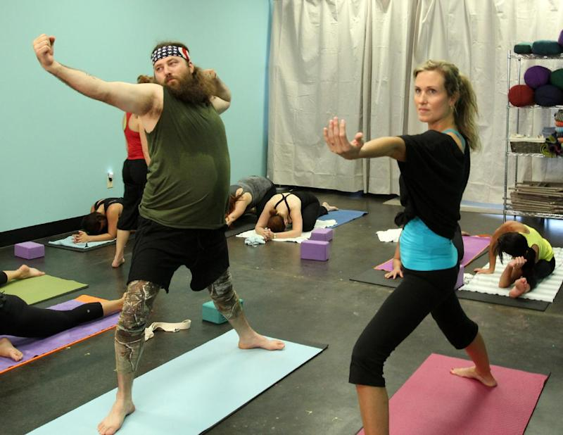 """This publicity image released by A& E shows, Willie Robertson, left, and his wife Korie Robertson in a scene from """"Duck Dynasty,""""  airing Wednesdays at 10 p.m. EST. (AP Photo/A&E, Art Streiber)"""