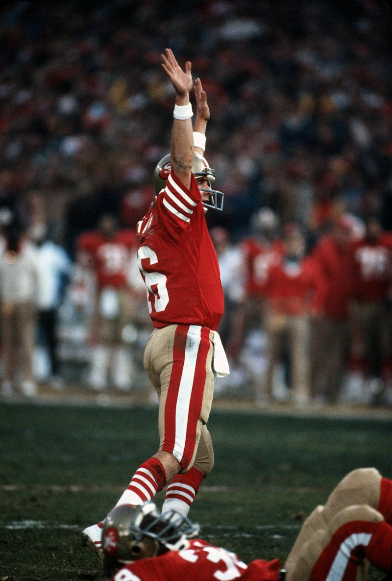 MIAMI, FL- JANUARY 31: Joe Montana #16 of the San Francisco 49ers celebrates after they scored a touchdown against the Cincinnati Bengals during Super Bowl XXIII on January 31, 1989 at Joe Robbie Stadium in Miami, Florida. The 49ers won the Super Bowl 20-16. (Photo by Focus on Sport/Getty Images)