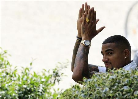 AC Milan's player Kevin-Prince Boateng acknowledges supporters at the Milanello training center in Carnago, northern Italy July 8, 2013. REUTERS/Alessandro Garofalo/Files