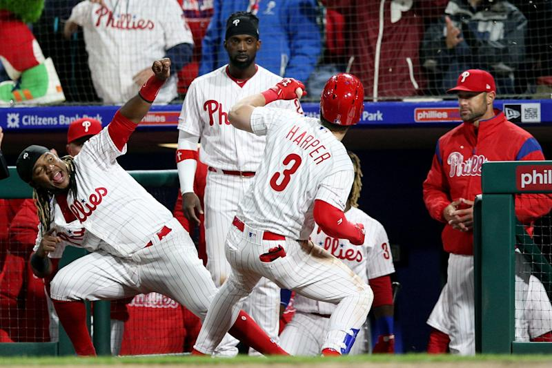 PHILADELPHIA, PA - MARCH 31: Bryce Harper #3 of the Philadelphia Phillies is greeted by teammate Maikel Franco #7 after hitting a home run in the seventh inning during the game between the Atlanta Braves and the Philadelphia Phillies at Citizens Bank Park on Sunday, March 31, 2019 in Philadelphia, Pennsylvania. (Photo by Rob Tringali/MLB Photos via Getty Images)