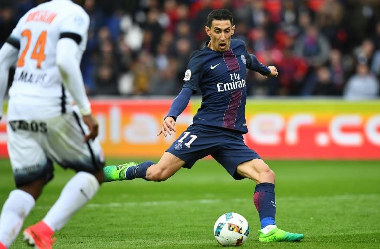 Paris Saint-Germain's Angel Di Maria (R) shoots during their match against Montpellier at the Parc des Princes stadium in Paris on April 22, 2017