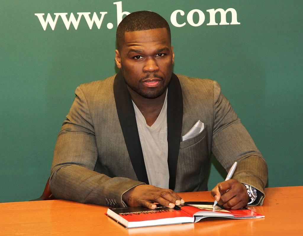 "NEW YORK, NY - JANUARY 16:  50 Cent, aka Curtis Jackson promotes his new book ""Formula 50: A 6-Week Workout and Nutrition Plan That Will Transform Your Life"" at Barnes & Noble, 5th Avenue on January 16, 2013 in New York City.  (Photo by Rob Kim/FilmMagic)"