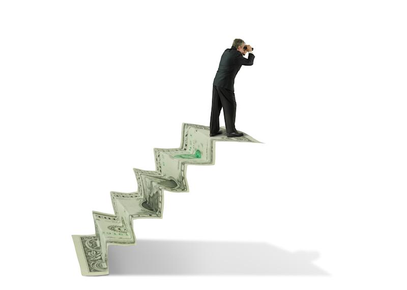 Man on a staircase made of money, looking through binoculars towards the future.