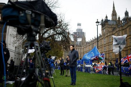 TV crews work outside the Houses of Parliament, after Prime Minister Theresa May's Brexit deal was rejected, in London, Britain, January 16, 2019. REUTERS/Clodagh Kilcoyne