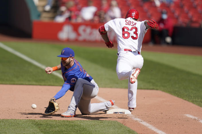 St. Louis Cardinals' Edmundo Sosa (63) grounds out as New York Mets first baseman Pete Alonso handles the throw during the ninth inning of a baseball game Thursday, May 6, 2021, in St. Louis. (AP Photo/Jeff Roberson)