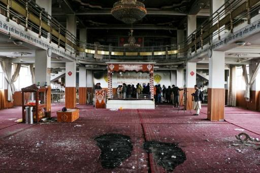 Security personnel and journalists inspect the Sikh-Hindu temple in Kabul, Afghanistan after a deadly attack highlighting the country's ongoing security crisis