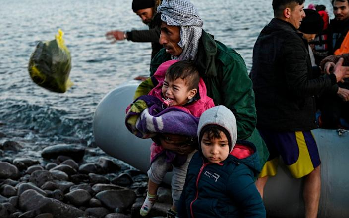 Asylum seekers land on Lesbos in March this year - AFP