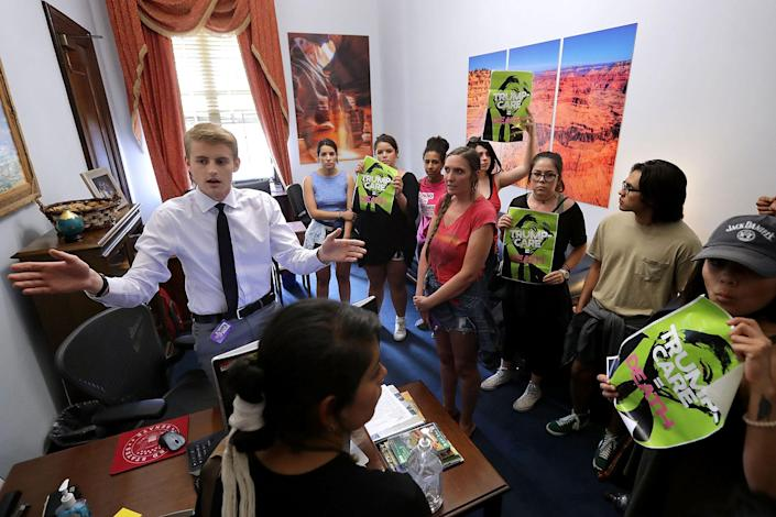 """<p>A staff member asks journalists to leave as demonstrators from Arizona chant, """"Kill the bill or lose your job"""" in the offices of Sen. Jeff Flake (R-AZ) during a protest against health care reform legislation in the Russell Senate Office Building on Capitol Hill July 10, 2017 in Washington, D.C. (Photo: Chip Somodevilla/Getty Images) </p>"""